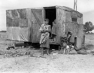 Children in a democracy. A migratory family living in a trailer in an open field. No sanitation, no water. They come from Amarillo, Texas. - photo by Dorothea Lange, Bureau of Agricultural Economics (Nov.)